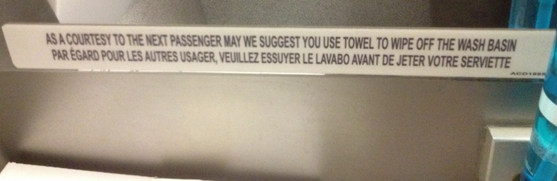 Bathroom Sign Next as a courtesy to the next passenger | normative signs: the poetry